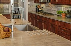 contemporary kitchen by Craftwork Concrete counter with integrated drain rack and undermount sink. Farmhouse Sink Kitchen, Kitchen Redo, New Kitchen, Kitchen Remodel, Kitchen Dining, Dark Countertops, Concrete Countertops, Kitchen Countertops, Kitchen Countertop Materials