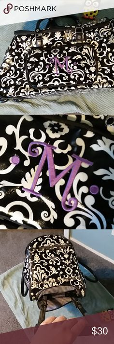 """ThirtyOne Rolling Duffel with M monogram EUC black and white rolling duffel from 31 gifts. Monogrammed """"M"""" in purple on front pocket. Perfect for a weekend getaway! ThirtyOne Bags Travel Bags"""