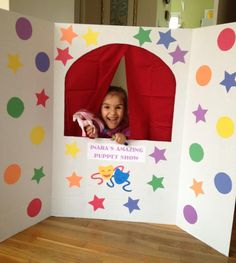 display board turned puppet theater, she loves it!