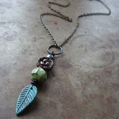 The sweet call of your hopes and dreams are nestled away as you hatch a plan to make them real. The feather and nest pendant is a trio of handcrafted artisan beads from three different artists. The dreamy teal feather is polymer clay, an earthy faceted ceramic bead rests in the middle and the top is an amazing subuichi metal nest. Subuichi is ancient Japanese mix of copper and silver to create a beautifully rustic alloy. Measurements: