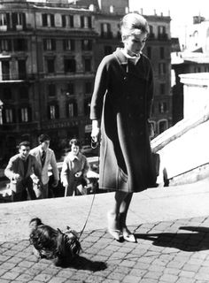 Audrey Hepburn & Mr. Famous (her Yorkshire Terrier) walking in Rome (Italy), 1960.