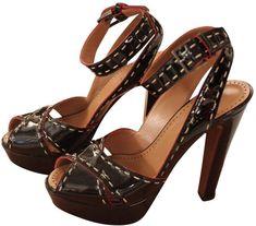 e73b09d484d Alaia Patent leather sandals