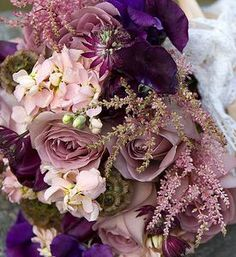 Purple wedding flowers www.myfloweraffair.com