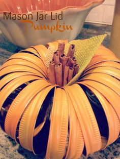 Mason Jar Lid Pumpkin - made one of these and painted it a dark metallic bronze and used a stick from the backyard.  With just a little twine for a bow, this quickly became my favorite fall decor in the house!