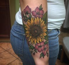 Loving the idea of this with primroses and violets surrounding the sunflower for my birthday tattoo ☺