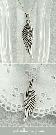 Angel wing pendant necklace in sterling silver.