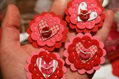 Thinking of doing something similar to these felt embellishments in order to make some Valentine's pins for children