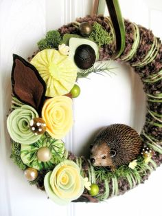 I adore this funky hedgehog decorated felt wreath.
