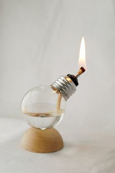 Recycled Light Bulb Oil Lamp on Natural Wood Half Dome Base @ Do It Yourself Remodeling Ideas