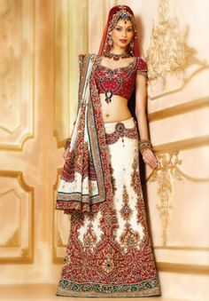 BW78 Off-white & Maroon Lehenga PANETAR A heavy panetar bridal with a jeweled choli and brocade skirt with zardozi and stones embroidery with one off-white brocade dupatta with embroidered pallu and big buttes; and a net dupatta to complete the look