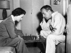 Joan Bennett and Humphrey Bogart enjoy a game chess during filming of We ...