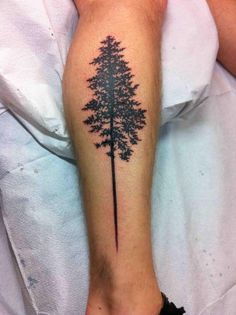 Silhouette Tree Tattoo On Leg by Sadie Kennedy