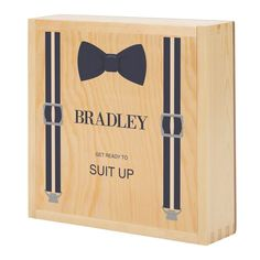 Pack your wedding party's favorite things in a box personalized for them with our Personalized Wooden Groomsmen Gift Box! This wooden gift box features a clever sliding lid, which can reveal anything from a flask filled with his favorite whiskey to a set of personalized cufflinks.