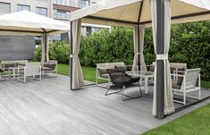 The rarest and most precious quartzites have inspired this ceramic product that transmits all the force and beauty of a stone. Elegant veining embellishes the two grey shades. Stoneware, Pergola, Two By Two, Shades, Outdoor Structures, Patio, Ceramics, Elegant, Outdoor Decor
