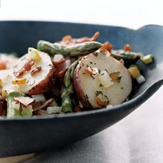 This salad is no bland picnic side dish: Slices of deli ham and bits of salty bacon give it hearty main-course appeal.