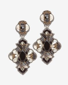 Ranjana Khan Embellished Statement Earrings: Black: Black stones are stitched onto silk taffeta and drop from crystal and metal stud accents. Measures: 2.9 x 1.3 . Clip on style. In black. Made in ...