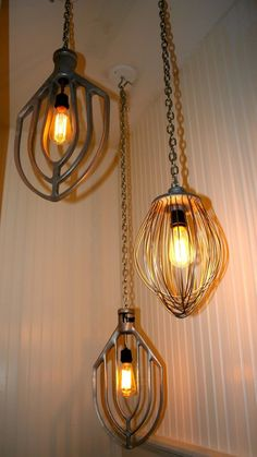 Old kitchen wisks repurposed into hanging light by using a light kit from a home improvement store can also do different levels with the chandelier