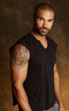 Image detail for -Actor Shemar Moore showing the lion tattoo on his right arm.