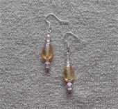Light brown iridescent glass beads and pink Swarovski crystal beads. Silver spacers and fish hook earring. Price: $6.00