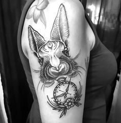 A creative tattoo idea of a rabbit face with a clock in dotwork style. Style: Do. Bunny Tattoos, Rabbit Tattoos, Girl Tattoos, Clock Tattoo Design, Tattoo Designs, Tattoo Ideas, Creative Tattoos, Great Tattoos, Back Tattoo Women