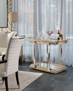 This stainless steel & glass serving cart in Marge Carson's new Malibu Collection is a hostess' best friend!