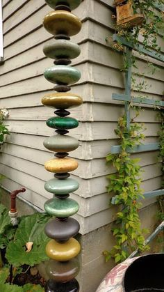 ceramic disks or rocks stacked on top of each other with wire running through the middle for a creative and fun rainchain