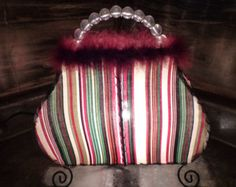 VINTAGE PURSE BOUDOIR Lamp - Accent Table Lamp Cloth and Feathers, and a lot of FUN mixed in! It looks very pretty when lit, it glows all of the colors like something out of Aladdin's Arabia! Vintage Lamps, Buy And Sell, Purses, Boudoir, Table Lamp, Handmade, Stuff To Buy, Etsy, Color