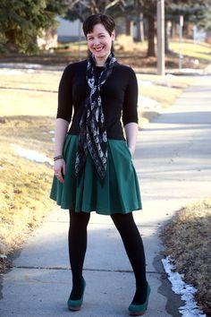 Black 3/4 sleeve tee, McQueen skull scarf, full green skirt, black opaques, platform pumps