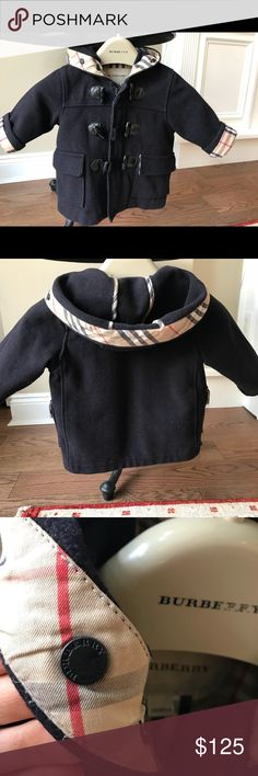 Authentic Burberry Wool Toddler Duffle/Toggle Coat DETAILS:  - Authentic  - Outer: 100% wool with polyester lining - Lining and front pockets with classic Burberry check lining - Burberry inscription on buttons, toggles, & zipper   - Beautiful pre-owned coat in very good condition.  - From a pet free/smoke free home.  - One of the rope toggle closures has some pulls on the end (see last picture) but nothing major.  - There is some slight reddish discoloration on the bottom interior lining of…