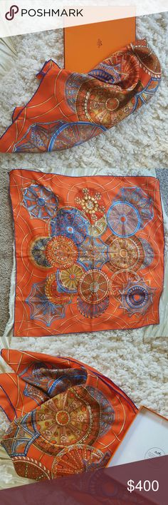 Authentic Hermes Silk Scarf Always Authentic Hermes Silk Scarf. Comes with original box. 35 in x35 in.,this is a big scarf!. EUC NO flaws to note, gently used. Actually purchased at the Hermes Flagship store in Paris. I just never reach for it.   No trades!  No low ball offers. They will be ignored. Please consider fees. I would prefer to sell on Tradesy for free  authentication for buyer. Hermes Accessories Scarves & Wraps