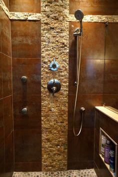 porcelain tile looks like metal; toiletries hide in half wall