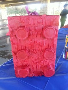 Lego pinata I made out of a cereal box (the big Costco or Sam's club ones) red solo cups and red streamer. Mix glue and water together and paint the glue on the box with a paintbrush. Cute and thrifty