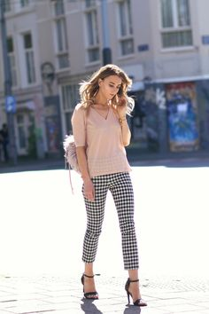 Noor De Groot is in a stylish pair of gingham trousers from Zara