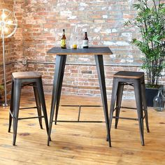 Versatile and stylish with an industrial feel, this pub table set is a perfect piece to achieve the rustic warehouse vibe in your home. Constructed from steel and wood this 3 piece set was built to last. Designed with style in mind, you'll love the rustic warehouse vibe combined with the timeworn charm.