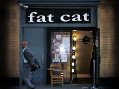fat cat has 10 pool tables, 10 ping pong tables, 3 shuffleboard tables, 3 foosball machines, chess (with time clocks), checkers, backgammon, and scrabble. you taught me how to play all of it.