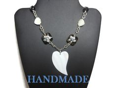 Use code SOCIAL15 for 15% off all purchases over $15, plus FREE shipping on most jewelry! Heart necklace pendant, mother of pearl, #vintage black glass, MOP heart beads, Czech crystal lampwork floral beads, handmade infinity links.  The black faceted vintage bead... #etsygifts #vjse2 #jewelry #gift