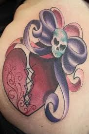 broken heart skull bow tattoo