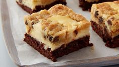 Triple-layered lusciousness, all in one bar: Brownies on the bottom, creamy cheesecake in the middle and tender chocolate chip cookies on top.