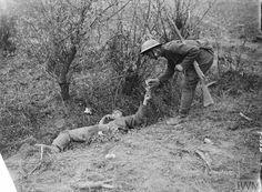 Battle of pilckem ridge. British and German soldier sharing a cigarette .