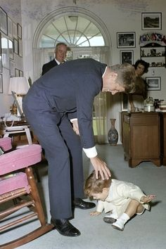 The Kennedy White House: JFK tousles John's hair.