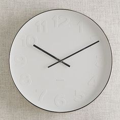Mr. White Wall Clock - West Elm - $149 - Crate and Barrel has a similar option for less