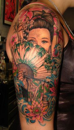 Beautiful geisha tattoo, absolutely stunning colours and detail