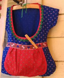 Drindl Clothespin Bag. Learn how to make a clothespin with this useful tutorial. How cute is this little dirndl dress clothespin bag?