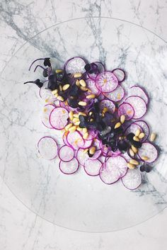 shaved purple radishes with radish sprouts, pine nuts, lemon zest