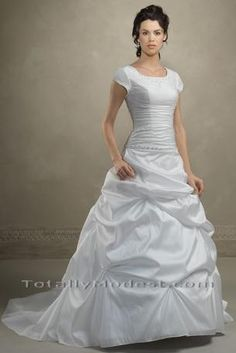 I have seen tons of wedding dresses and this one totally caught my eye. I love how fitting it is, but it doesn't look too tight. Something different could be done with the bottom but overall...I think my favorite dress I've seen