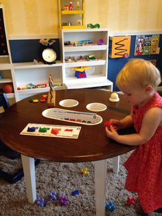 This is a fun way to keep activities on the table and still out of the way.  Buckets Built in!  It also helps keep loose toys more organized when in use.
