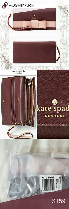 """NWT KATE SPADE SAFFIANO BOW WALLET/WRISTLET What a cute wallet. So practical with the wristlet strap. Let me know if u want pics of anything specific.  Crosshatched leather with matching trim Capital kate jacquard lining  Continental wallet with snap closure  Removable wristlet straps 4 credit card slots 2 billfolds Zipper change pocket  3.9"""" x 7.4""""   Bought directly from kate spade.        Authentic coach dooney and bourke Michael kors kate spade Bags Wallets"""