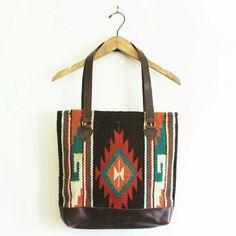 "Southwest aztec saddleblanket bag - medium Woven wool saddleblanket body panel. Vegan brown leather handles and bottom panel. Zipper closure. Fully lined. 13"" wide 14.5"" tall 10.5"" strap drop Vera Lyndon  Bags Totes"