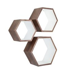 These walnut Nesting Hexagon Shelves are the ultimate stylish yet functional addition to your living space. They offer a surprising amount of space to display your favorite decorative items. Showcasing...  Find the Walnut Nesting Hexagon Shelves - Set of 3, as seen in the Labor Day Sale: Furniture Collection at http://dotandbo.com/collections/labor-day-sale-furniture?utm_source=pinterest&utm_medium=organic&db_sku=HX0002-WHT