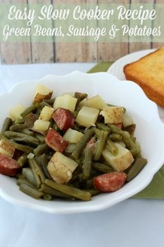 Easy Slow Cooker Recipe ~ Green Beans, Sausage and potatoes Looking for an easy slow cooker recipe that can be put together in less than 10 minutes? Perhaps you need a new side dish? Green beans, sausage and potatoes is perfect! Sausage And Green Beans, Smoke Sausage And Potatoes, Crockpot Green Beans, Crock Pot Potatoes, Crock Pots, Red Beans, Crock Pot Slow Cooker, Slow Cooker Recipes, Cooking Recipes